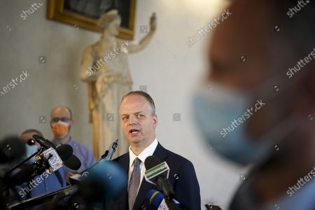 Uffizi Gallery museum director Eike Schmidt talks to reporters at a press conference on the reopening day of the museum, in Florence, . The Uffizi museum reopened to the public after over two months of closure due to coronavirus restrictions