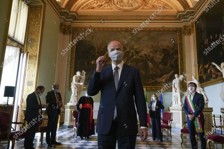 Uffizi Gallery museum director Eike Schmidt wears a face mask to prevent the spread of COVID-19 as he arrives for a press conference on the reopening day of the museum, in Florence, . The Uffizi museum reopened to the public after over two months of closure due to coronavirus restrictions