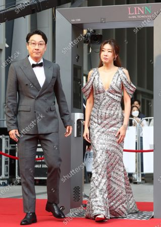 South Korean comedian Lee Hwi-jae (L) and fashion model Han Hye-jin walk down the red carpet at the 56th Daejong Film Awards ceremony in Seoul, South Korea, 03 June 2020. Lee and Han, who are the emcees for this year's event, went through a non-contact walk through temperature check gate, as part of precautions to prevent the spread of COVID-19.