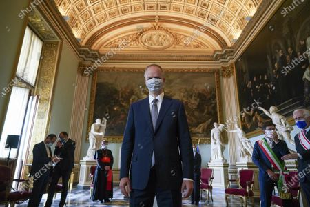 Uffizi Gallery museum director Eike Schmidt wears a face mask to prevent the spread of COVID-19 as he poses for photographers on the reopening day of the museum, in Florence, . The Uffizi museum reopened to the public after over two months of closure due to coronavirus restrictions