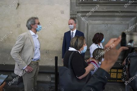 Uffizi museum director Eike Schmidt, center, looks at the first visitors arriving on the reopening day of the museum, in Florence, . The Uffizi museum reopened to the public after over two months of closure due to coronavirus restrictions