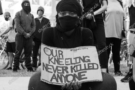 A protestor demonstrates at City Hall in Oakland, California on June 2, 2020 after the death of George Floyd.