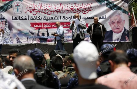 Palestinians take part in a protest against a US-brokered peace proposal in the West Bank city of Nablus, on June 3, 2020. The plan, launched by US President Donald Trump, proposes granting Israel several of its key long-held wishes, including full sovereignty over the disputed city of Jerusalem and the right to annex all settlements in the occupied West Bank. In exchange the Palestinians would be granted a demilitarised state in the remaining parts of the West Bank and Gaza, but the offer was immediately rejected by Palestinians from across the political spectrum, who saw it as biased towards Israel.