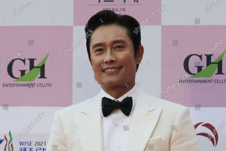 South Korean actor Lee Byung-hun smiles for a photo on the red carpet at the 56th Daejong Film Awards ceremony in Seoul, South Korea