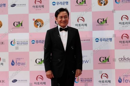 South Korean actor Ahn Sung-ki smiles for a photo on the red carpet at the 56th Daejong Film Awards ceremony in Seoul, South Korea