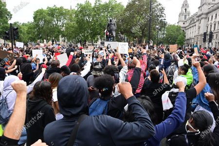 Members of the campaign group Black Lives Matter and supporters, at Parliament Square in central London to demonstrate, following the death of African American George Floyd while in police custody. The death of George Floyd, who died after being restrained by a police officer In Minneapolis, Minnesota, has caused widespread rioting and looting across the U. S. A.