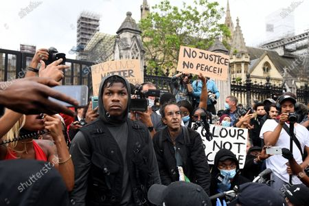 Stock Photo of Protestors including British actor John Boyega (C) demonstrate at a Justice for Black Lives protest in London, Britain, 03 June 2020. Protesters gathered in front of the embassy to express their feelings in regard to the death of 46 year old George Floyd while in police custody. A bystander's video posted online on 25 May appeared to show George Floyd, 46, pleading with arresting officers that he couldn't breathe as an officer knelt on his neck, in Minnesota, USA. The unarmed black man later died in police custody.