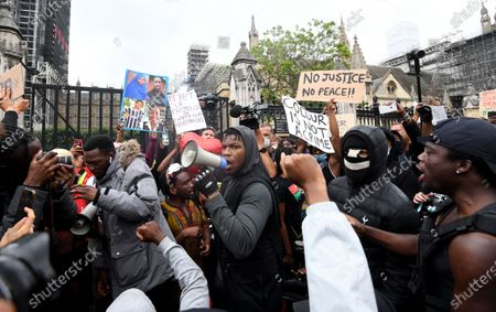 Protestors including British actor John Boyega (C) demonstrate at a Justice for Black Lives protest in London, Britain, 03 June 2020. Protesters gathered in front of the embassy to express their feelings in regard to the death of 46 year old George Floyd while in police custody. A bystander's video posted online on 25 May appeared to show George Floyd, 46, pleading with arresting officers that he couldn't breathe as an officer knelt on his neck, in Minnesota, USA. The unarmed black man later died in police custody.