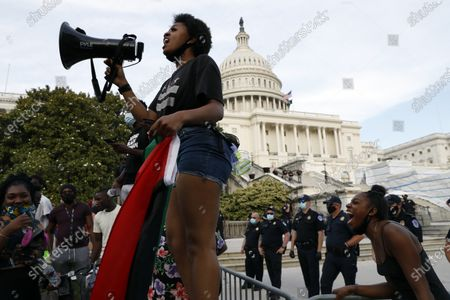 Stock Photo of Skye Webster, 22, of Washington, speaks as demonstrators protest the death of George Floyd, at the U.S. Capitol in Washington. Floyd died after being restrained by Minneapolis police officers