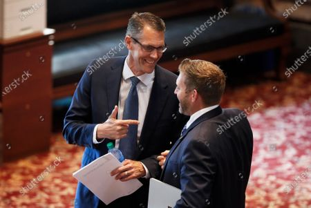 Sen. Randy Feenstra, R-Hull, left, laughs with Sen. Jake Chapman, R-Adel, in the Iowa Senate chambers, at the Statehouse in Des Moines, Iowa. Feenstra defeated incumbent U.S. Rep. Steve King, R-Iowa, in Iowa's Tuesday Republican primary. Lawmakers returned Wednesday after suspending the session when the coronavirus pandemic surfaced in Iowa in March, prompting state officials to close the state Capitol