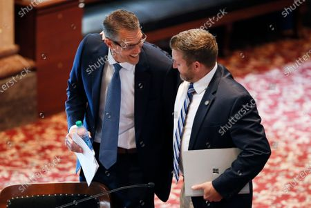 Stock Photo of Sen. Randy Feenstra, R-Hull, left, laughs with Sen. Jake Chapman, R-Adel, in the Iowa Senate chambers, at the Statehouse in Des Moines, Iowa. Feenstra defeated incumbent U.S. Rep. Steve King, R-Iowa, in Iowa's Tuesday Republican primary. Lawmakers returned Wednesday after suspending the session when the coronavirus pandemic surfaced in Iowa in March, prompting state officials to close the state Capitol