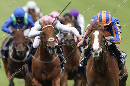 NEWMARKET, ENGLAND - JUNE 07: Ryan Moore riding Love (R, blue/orange) win The Qipco 1000 Guineas Stakes at Newmarket Racecourse on June 07, 2020 in Newmarket, England. (Photo by Alan Crowhurst/Getty Images), supplied by Hugh Routledge via racing Photographers' Pool.