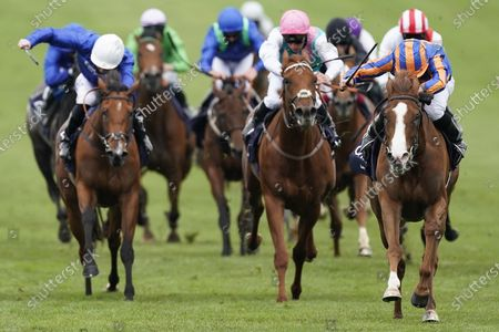 NEWMARKET, ENGLAND - JUNE 07: Ryan Moore riding Love (R, blue/orange) win The Qipco 1000 Guineas Stakes at Newmarket Racecourse on June 07, 2020 in Newmarket, England. (Photo by Alan Crowhurst/Getty Images) , supplied by Hugh Routledge via Racing Photographers' Pool.