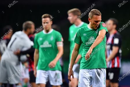 Hans Carl Ludwig Augustinsson of SV Werder Bremen looks dejected after losing the German Bundesliga soccer match between SV Werder Bremen and Eintracht Frankfurt at Wohninvest Weserstadion in Bremen, Germany, 03 June 2020.