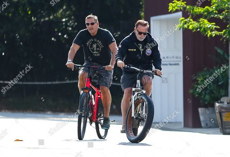 Arnold Schwarzenegger and Ralf Moeller are seen out for a morning bike ride during quarantine