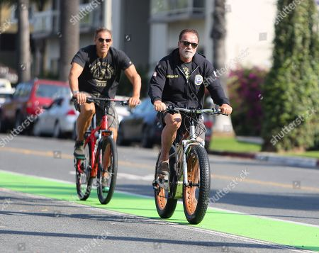 Stock Picture of Arnold Schwarzenegger and Ralf Moeller are seen out for a morning bike ride during quarantine