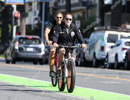 Stock Photo of Arnold Schwarzenegger and Ralf Moeller are seen out for a morning bike ride during quarantine