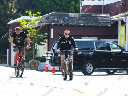 Stock Image of Arnold Schwarzenegger and Ralf Moeller are seen out for a morning bike ride during quarantine