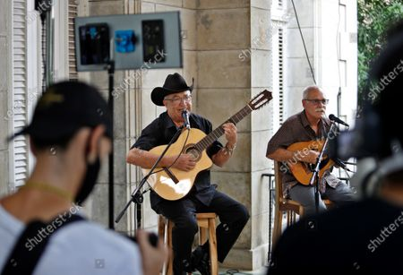 Eliades Ochoa (2-R), accompanied by the lute player Barbarito Torres (R), both members of Buena Vista Social Club, during an online concert in Havana, Cuba, 02 June 2020 (issued on 03 June 2020). Several Cuban artists have chosen to offer concerts that will be broadcast via streaming with the support of the Ministry of Culture and the Cuban Institute of Music (ICM), at ICM headquarters.