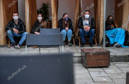 Stock Picture of People watch black comedy movie directed by Yorgos Lanthimos 'The Favourite' in an outdoor cinema at a patio, amid the ongoing coronavirus COVID-19 pandemic in Lublin, eastern Poland, 03 June 2020.