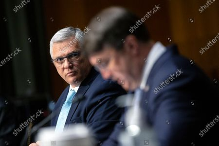 Dr. Richard Stone, Executive in Charge of the Veterans Health Administration, listens as United States Secretary of Veterans Affairs (VA) Robert Wilkie testifies before the United States Senate Committee on Veteran's Affairs on Capitol Hill in Washington D.C., U.S.,.