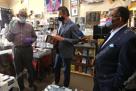 James Fugate, co-owner of Eso Won Books, speaks with California Governor Gavin Newsom and Los Angeles Supervisor Mark Ridley-Thomas while touring businesses in Leimert Park after days of protests in Los Angeles, California, USA, on 03 June 2020. Fugate suggested the book, 'Chokehold: Policing Black Men', by Paul Butler, to the governor for being a timely book after the death of George Floyd in Minneapolis.