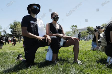 Stock Photo of Golden State Warriors player Stephen Curry (L) and his wife Ayesha (R) during a demonstration over the arrest in Minnesota of George Floyd, who later died in police custody, in Oakland, California, USA, 03 June 2020. A bystander's video posted online on 25 May, appeared to show George Floyd, 46, pleading with arresting officers that he couldn't breathe as an officer knelt on his neck. The unarmed black man later died in police custody.