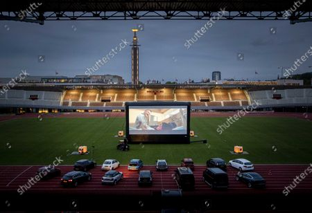 People attend in their cars the first drive-in film by film director Martin Koolhoven at the Olympic Stadium, in Amsterdam, The Netherlands, 03 June 2020. The screening is offered to thirty people with vital occupations. Because of the corona measures, no more people are allowed.