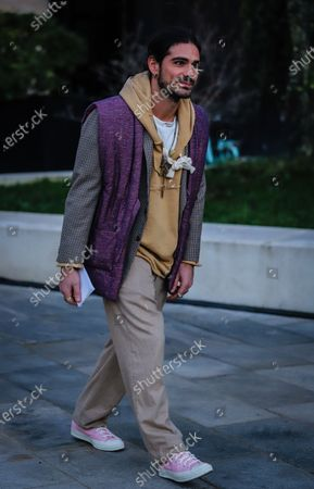 Stock Picture of MILAN, Italy- January 11 2020: Giotto Calendoli on the street during the Milan Fashion Week.
