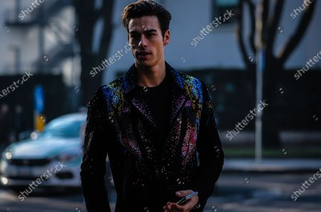 MILAN, Italy- January 11 2020: Corentin Huard on the street during the Milan Fashion Week.