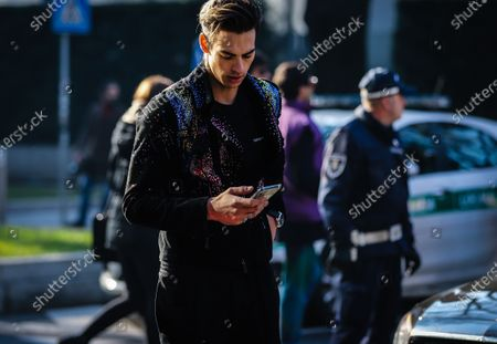 Stock Photo of MILAN, Italy- January 11 2020: Corentin Huard on the street during the Milan Fashion Week.