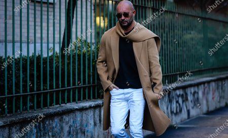 MILAN, Italy- January 11 2020: Milan Vukmirovic on the street during the Milan Fashion Week.