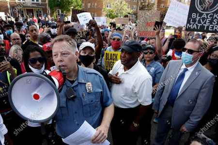 Kansas City police Chief Rick Smith talks to protesters, in Kansas City, Mo., during a unity march to protest against police brutality following the death of George Floyd, who died after being restrained by Minneapolis police officers on May 25