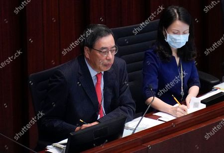 Andrew Leung, left, President of the Legislative Council of Hong Kong, looks on at the main chamber of the Legislative Council in Hong Kong, . Hong Kong's legislature approved a contentious bill Thursday that makes it illegal to insult the Chinese national anthem. The legislation was approved after pro-democracy opposition lawmakers tried to disrupt the vote