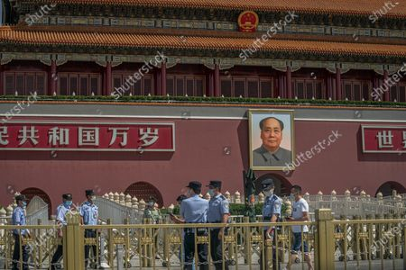 Chinese policemen wearing protective face masks stand guard in front of the Chairman Mao portrait on the south gate of the Forbidden City, near the Tiananmen Square, in Beijing, China, 04 June 2020. 04 June 2020 marks the 31st anniversary of the 1989 Tiananmen Square protests. Between 15 April and 04 June 1989, students, intellectuals, and activists engaged in a series of demonstrations against the Chinese Communist Party where the subsequent crackdown by authorities caused many civilians' deaths and injuries. Since then, no official death toll has been released by Chinese officials. However, rights groups estimate hundreds if not thousands were killed while many people were jailed in a subsequent purge. The Tiananmen Square protest remains one of the most widely censored topics in China.
