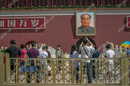 Tourists stand in front of the Chairman Mao portrait on the south gate of the Forbidden City, near the Tiananmen Square, in Beijing, China, 04 June 2020. 04 June 2020 marks the 31st anniversary of the 1989 Tiananmen Square protests. Between 15 April and 04 June 1989, students, intellectuals, and activists engaged in a series of demonstrations against the Chinese Communist Party where the subsequent crackdown by authorities caused many civilians' deaths and injuries. Since then, no official death toll has been released by Chinese officials. However, rights groups estimate hundreds if not thousands were killed while many people were jailed in a subsequent purge. The Tiananmen Square protest remains one of the most widely censored topics in China.