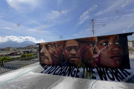 A view of a huge mural created by Italian street artist Jorit Agoch in memory of George Floyd in Naples, southern Italy, 04 June 2020. The 46-year-old Floyd died in police custody in Minneapolis, Minnesota, USA on 25 May 2020, after police officer Derek Chauvin pressed a knee on the neck of the handcuffed African-American man lying on the ground for almost nine minutes, reports state. Faces of Lenin, Martin Luther King, Malcom X and Angela Davis are also painted on the mural.