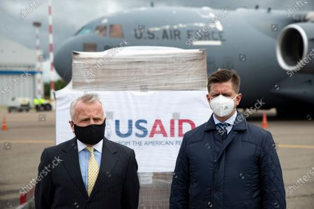 U.S. Ambassador to Russia John Sullivan (L) and Dmitry Nikitenko, the first deputy general director of the Pirogov's National Medical and Surgical Centre, speak to the media in front of the batch of medical aid from the United States, including medical ventilators as a donation to help the country tackle the coronavirus outbreak, at Vnukovo International Airport outside Moscow, Russia, 04 June 2020. The United States has delivered a batch of medical ventilators to Russia as a humanitarian donation to help the country cope with the coronavirus outbreak.