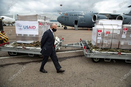 U.S. Ambassador to Russia John Sullivan walks past the batch of medical aid from the United States, including medical ventilators as a donation to help the country tackle the coronavirus outbreak, at Vnukovo International Airport outside Moscow, Russia, 04 June 2020. The United States has delivered a batch of medical ventilators to Russia as a humanitarian donation to help the country cope with the coronavirus outbreak.