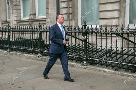 Liam Fox, COnservative MP for North Somerset walking in Whitehall