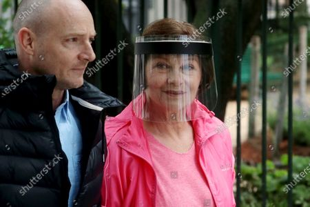 Macha Meril (R) wears a face shield as she attends the funeral ceremony of the French actor Guy Bedos at the Church of Saint-Germain-des-Pres in Paris, France, 04 June 2020. Bedos died at the age of 85 in Paris on 28 May 2020.