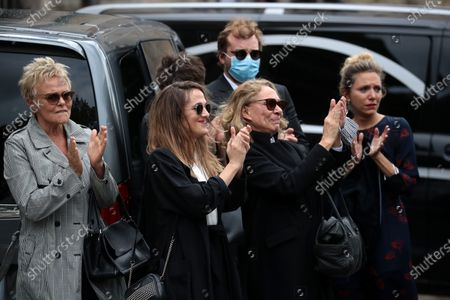 Guy Bedos' wife, Joelle Bercot (R), daughter Victoria Bedos (C) and French comedian Muriel Robin (L) attend the funeral ceremony of the French actor Guy Bedos at the Church of Saint-Germain-des-Pres in Paris, France, 04 June 2020. Bedos died at the age of 85 in Paris on 28 May 2020.