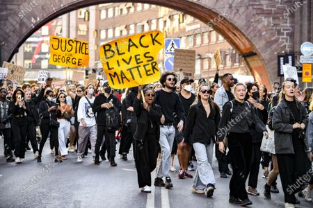 Protestors gather in at Sergel's square in Stockholm, Sweden, June 03, 2020, in support of the Black Lives Matter movement following the death of George Floyd in Minneapolis after being restrained by a white police officer. The crowds were ordered to disperse as they were violating the coronavirus restrictions. The protests then spilled into several other areas of Stockholm
