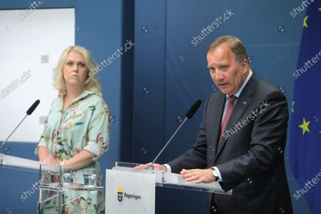 Swedish Social Minister Lena Hallengren (L) and Prime Minister Stefan Lofven hold a news conference regarding Sweden's domestic travel restrictions, in Stockholm, Sweden, 04 June 2020.