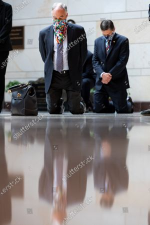 United States Senator Tim Kaine (Democrat of Virginia) kneels on the ground while the US Senate Democratic Caucus observes a moment of silence to commemorate the life of George Floyd, Ahmaud Arbery and Breonna Taylor and to stand in solidarity with Americans all across the country peacefully protesting racial injustice in the Emancipation Hall of the Capitol Visitor Center on Capitol Hill in Washington, District of Columbia.
