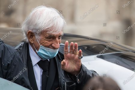 Stock Image of Jean-Paul Belmondo wears a face mask while waving to the public as he leaves the funeral ceremony for Guy Bedos at the Church of Saint-Germain-des-Pres in Paris, France, 04 June 2020. Bedos, an actor, stand-up comedian and screenwriter best known for his recurring role as Simon in 1970s comedies directed by Yves Robert, passed away on 28 May at the age of 85 in Paris. Born in Algeria, Bedos was very active in left-wing politics and gained popularity for his biting satirical sketches and impressions.