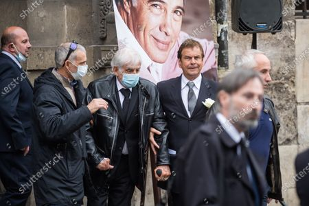Stock Picture of Jean-Paul Belmondo (C) and his son, Paul Belmondo (2-L), wear face masks as they leave the funeral ceremony for Guy Bedos at the Church of Saint-Germain-des-Pres in Paris, France, 04 June 2020. Bedos, an actor, stand-up comedian and screenwriter best known for his recurring role as Simon in 1970s comedies directed by Yves Robert, passed away on 28 May at the age of 85 in Paris. Born in Algeria, Bedos was very active in left-wing politics and gained popularity for his biting satirical sketches and impressions.
