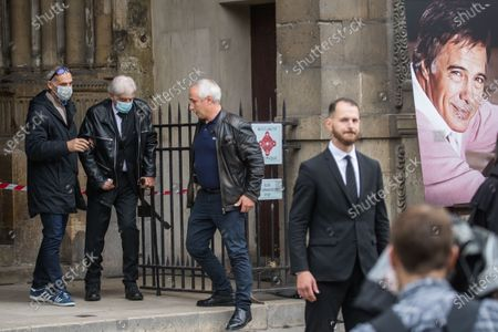 Jean-Paul Belmondo (2-L) and his son, Paul Belmondo (L), wear face masks as they leave the funeral ceremony for Guy Bedos at the Church of Saint-Germain-des-Pres in Paris, France, 04 June 2020. Bedos, an actor, stand-up comedian and screenwriter best known for his recurring role as Simon in 1970s comedies directed by Yves Robert, passed away on 28 May at the age of 85 in Paris. Born in Algeria, Bedos was very active in left-wing politics and gained popularity for his biting satirical sketches and impressions.