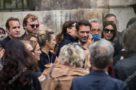 Stock Photo of Jean Dujardin (L), French actress Doria Tillier (C-L) and the son of Guy Bedos, Nicolas Bedos (C-R), chat following the funeral ceremony for Guy Bedos at the Church of Saint-Germain-des-Pres in Paris, France, 04 June 2020. Bedos, an actor, stand-up comedian and screenwriter best known for his recurring role as Simon in 1970s comedies directed by Yves Robert, passed away on 28 May at the age of 85 in Paris. Born in Algeria, Bedos was very active in left-wing politics and gained popularity for his biting satirical sketches and impressions.