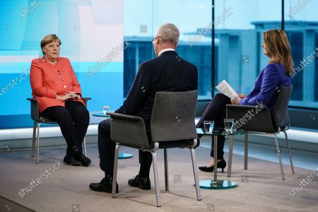 German Chancellor Angela Merkel (L) talks with journalists Rainald Becker (C) and Tina Hassel (R) prior to the beginning of the recording of the ARD TV show 'Farbe bekennen' (lit.: to show your colors) in Berlin, Germany, 04 June 2020. The German Chancellor is appearing on various TV shows, the evening after Germany unveiled a massive economic stimulus package amid the Covid-19 pandemic.